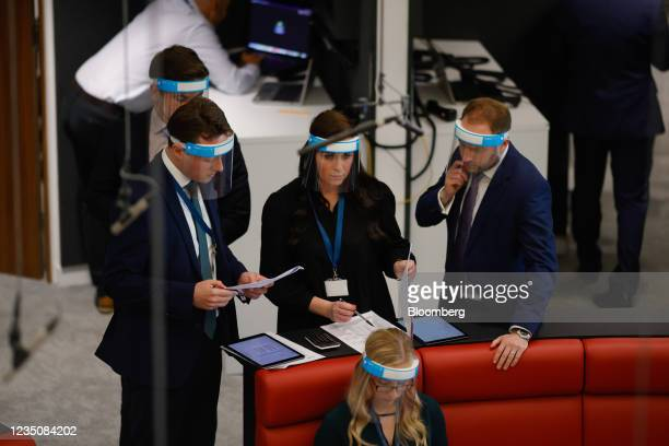 Traders wearing face shields on the trading floor of the open outcry pit at the London Metal Exchange Ltd. In London, U.K., on Monday, Sept. 6, 2021....