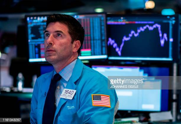Traders work after the closing bell at the New York Stock Exchange on August 12 2019 at Wall Street in New York City Wall Street stocks finished a...