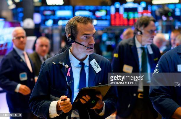 Traders work after the opening bell at the New York Stock Exchange on August 15, 2019 at Wall Street in New York City. - Wall Street stocks opened...