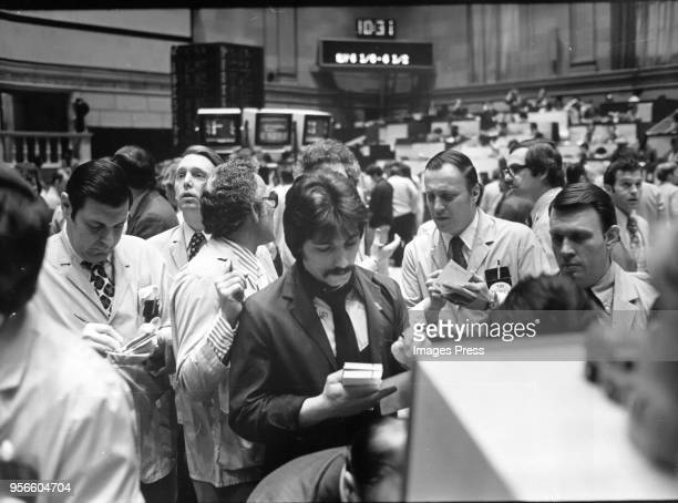 Traders work at the American Stock Exchange circa 1976 in New York City