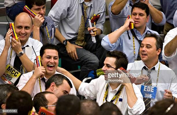 Traders work at the Bolsa de Mercadorias e Futuros or Brazilian Mercantile and Futures Exchange in Sao Paulo Brazil on Friday Oct 2008 Brazilian...
