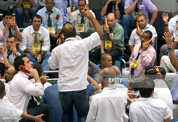 Traders work at the Bolsa de Mercadorias e Futuros or Brazilian Mercantile and Futures Exchange in Sao Paulo Brazil on Friday March 20 2009 Brazilian...