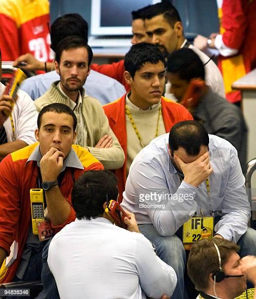 Traders work at the Brazilian Bolsa de Mercadorias e Futuros or Brazilian Mercantile and Futures Exchange in Sao Paulo Brazil on Monday Oct 6 2008...