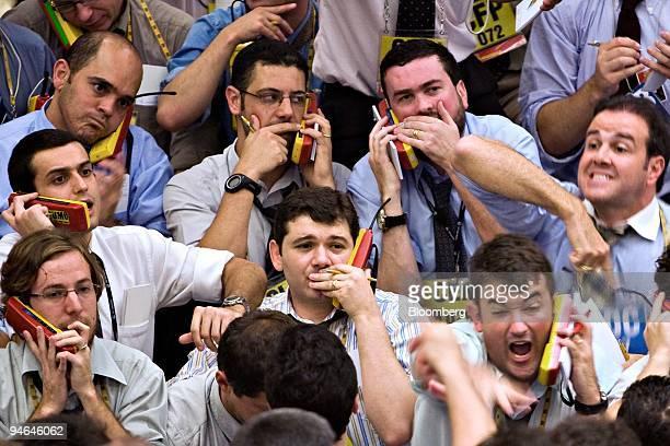 Traders work at the Brazilian Bolsa de Mercadorias e Futuros the Brazilian Mercantile and Futures Exchange or BMF in Sao Paulo Brazil Thursday Aug 16...