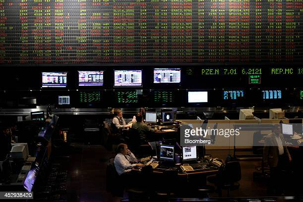 Traders work at the Buenos Aires Stock Exchange in Buenos Aires Argentina on Wednesday July 30 2014 A top Argentine banker and former Economy...