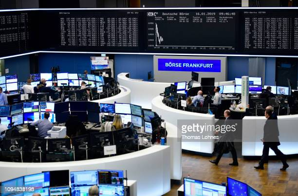 Traders work at the Frankfurt Stock Exchange the day after a large majority of MPs in the British House of Commons rejected British Prime Minister...