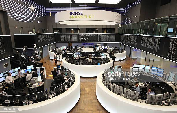 Traders work at the German Stock Exchange in Frankfurt am Main western Germany on December 30 the last day of trade of the year 2016 / AFP / DANIEL...