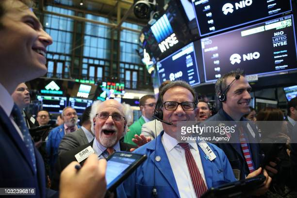 Traders work at the New York Stock Exchange in New York the United States on Sept 12 2018 NIO Inc a Chinese electric vehicle startup rang the New...