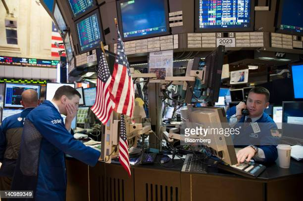Traders work at the New York Stock Exchange in New York US on Friday March 9 2012 US stocks rose sending the Standard Poor's 500 Index higher for a...
