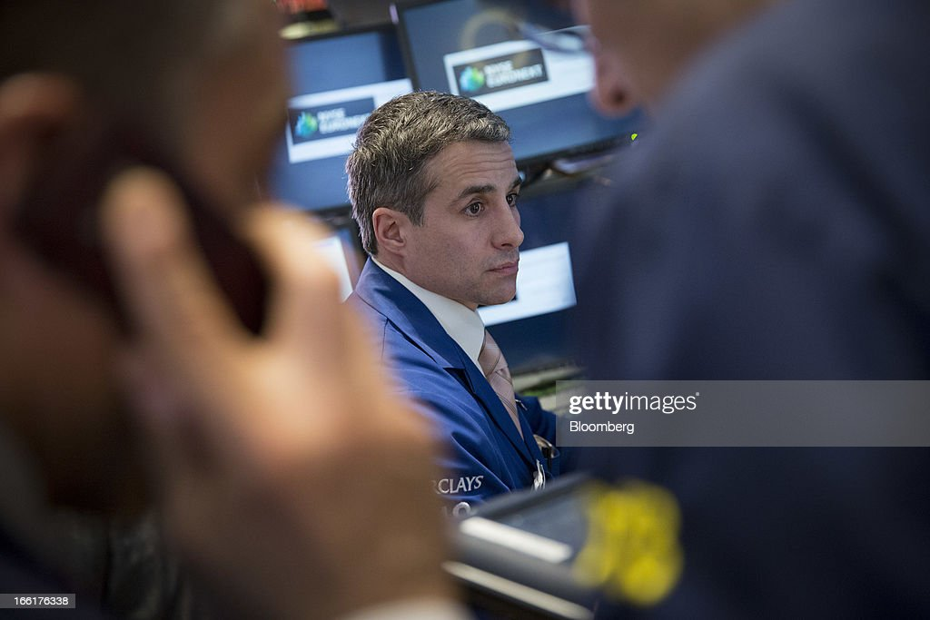 Traders work at the New York Stock Exchange (NYSE) in New York, U.S., on Tuesday, April 9, 2013. U.S. stocks rose, sending benchmark indexes toward record closing highs, on optimism over corporate earnings and as commodities gained amid a report showing China's inflation slowed. Photographer: Scott Eells/Bloomberg via Getty Images