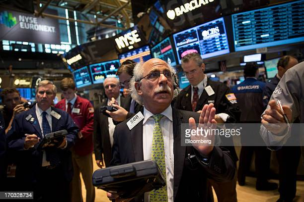 Traders work at the New York Stock Exchange in New York US on Tuesday June 11 2013 US stocks fell sending the Standard Poor's 500 Index lower for a...