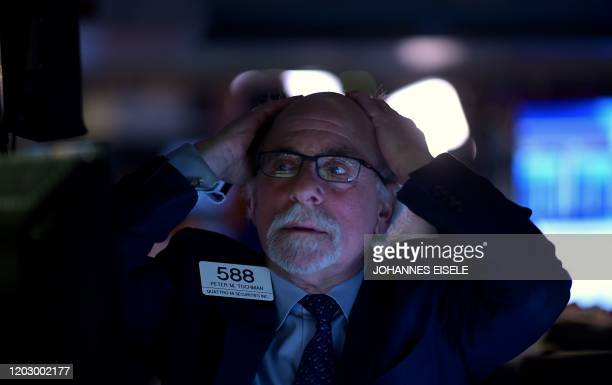 Traders work at the New York Stock Exchange on February 24 2020 at Wall Street in New York City Wall Street stocks finished with steep losses...