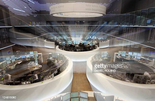 Traders work at the stock exchange in Frankfurt/M western Germany on September 12 2011 Germany's share index DAX temporarily fell below the mark fo...
