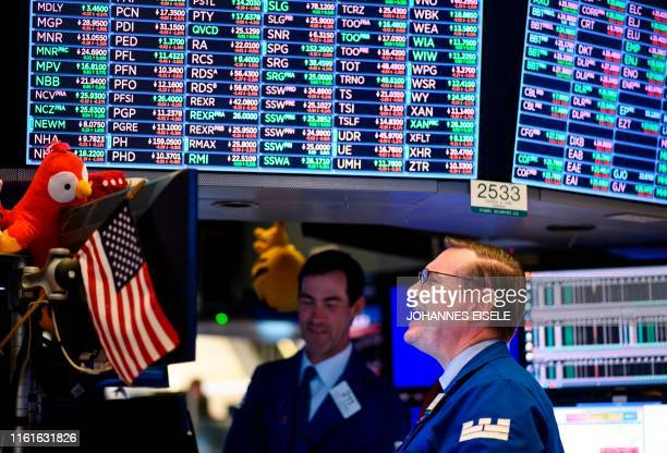 Traders work before the closing bell at the New York Stock Exchange on August 14 2019 in New York City It was an ugly day for Wall Street as stocks...