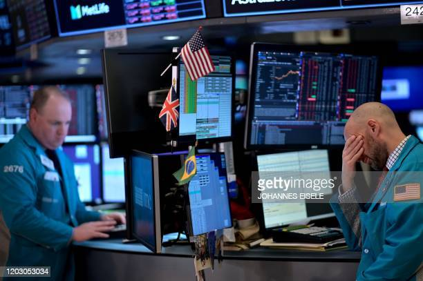 Traders work during the closing bell at the New York Stock Exchange on February 24 2020 at Wall Street in New York City Wall Street stocks finished...