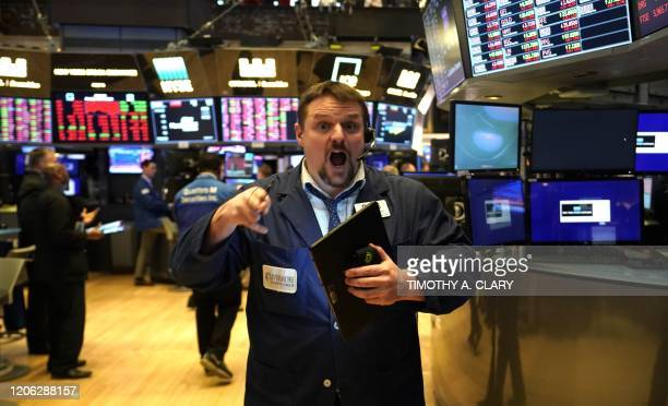 Traders work during the closing bell at the New York Stock Exchange on March 9 2020 on Wall Street in New York City Major Wall Street indices...