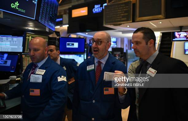 Traders work during the closing bell at the New York Stock Exchange on March 18 2020 at Wall Street in New York City Wall Street stocks plunged again...