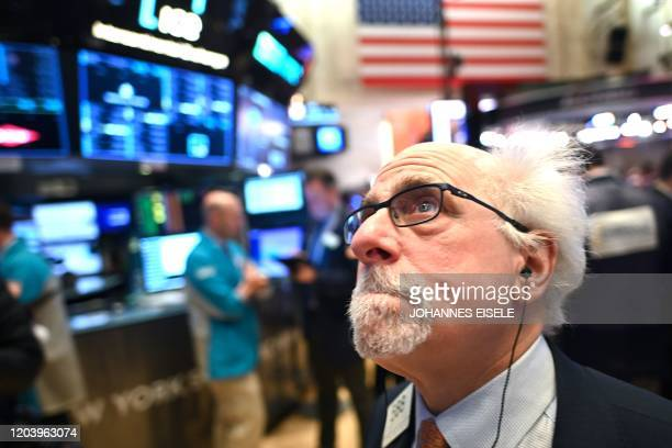 Traders work during the opening bell at the New York Stock Exchange on February 28, 2020 at Wall Street in New York City. - Losses on Wall Street...
