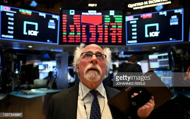 Traders work during the opening bell at the New York Stock Exchange on March 16 2020 at Wall Street in New York City Trading on Wall Street was...