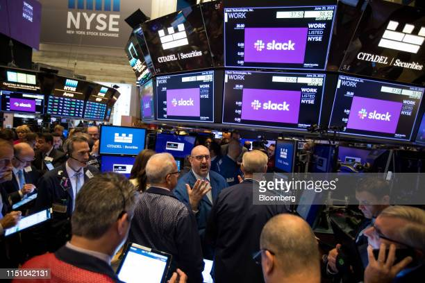 Traders work during the Slack Technologies Inc. Initial public offering on the floor of the New York Stock Exchange in New York, U.S., on Thursday,...