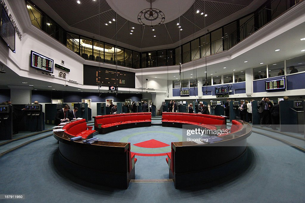 Traders work in booths around the perimeter of the trading floor during a break in sessions at the London Metal Exchange (LME) is seen in London, U.K., on Friday, Dec. 7, 2012. The London Metal Exchange's $2.2 billion takeover by the Hong Kong Exchanges & Clearing Ltd. was completed yesterday. Photographer: Simon Dawson/Bloomberg via Getty Images
