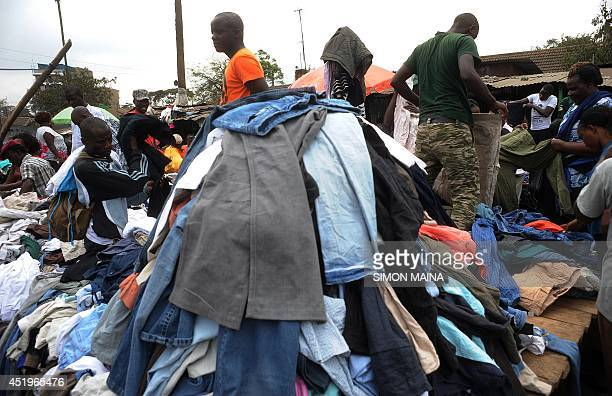 Traders work in Gikomba Market East Africa's biggest secondhand clothing market on July 10 2014 in Nairobi Locally known as Mitumba secondhand...