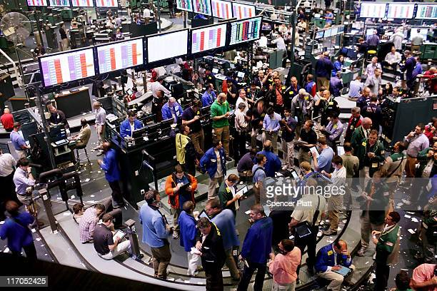 Traders work in the crude oil and natural gas options pit on the floor of the New York Mercantile Exchange on June 20 2011 in New York City Following...