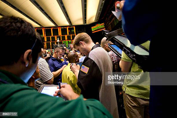 Traders work in the crude oil and natural gas options pit on the floor of the New York Mercantile Exchange in New York US on Wednesday June 10 2009...