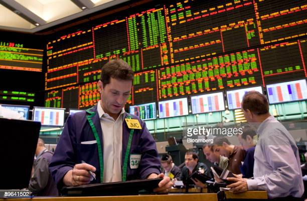 Traders work in the crude oil futures pit at the New York Mercantile Exchange in New York US on Friday June 5 2009 Crude oil rose in New York poised...