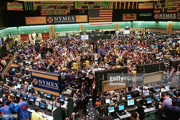 Traders work in the crude oil futures pit at the New York Mercantile Exchange on Thursday June 8 in New York Crude oil fell below $70 a barrel in New...