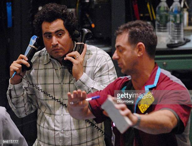 Traders work in the crude oil futures pit at the New York Mercantile Exchange in New York US on Thursday Sept 27 2007 in New York Crude oil rose for...