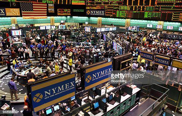 Traders work in the crude oil futures pit left and crude oil options pit right at the New York Mercantile Exchange in New York US on Wednesday Feb 20...