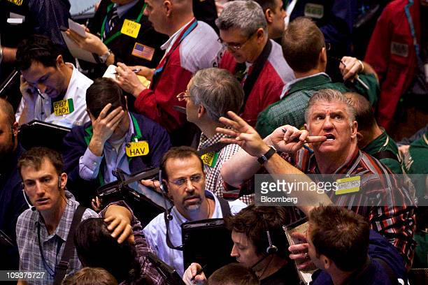 Traders work in the crude oil options pit at the New York Mercantile Exchange in New York US on Wednesday Feb 23 2011 Oil surged to $100 a barrel in...