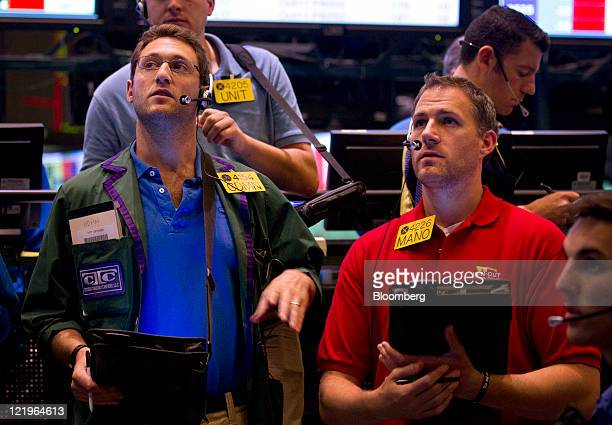Traders work in the crude oil options pit at the New York Mercantile Exchange in New York US on Wednesday Aug 24 2011 Crude oil advanced after an...