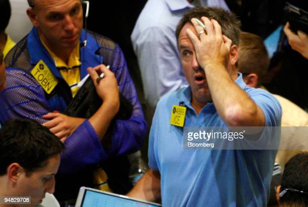 Traders work in the crude oil options pit at the New York Mercantile Exchange in New York US on Wednesday July 30 2008 Crude oil rose more than $1 a...