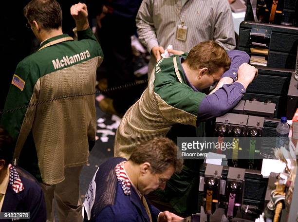 Traders work in the crude oil options pit at the New York Mercantile Exchange in New York US on Monday May 19 2008 Crude oil was little changed amid...