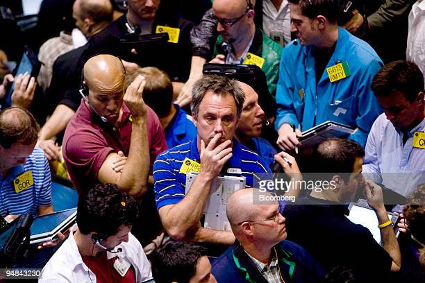 Traders work in the crude oil options pit at the New York Mercantile Exchange in New York US on Monday June 16 2008 Crude oil rose to a record $13989...