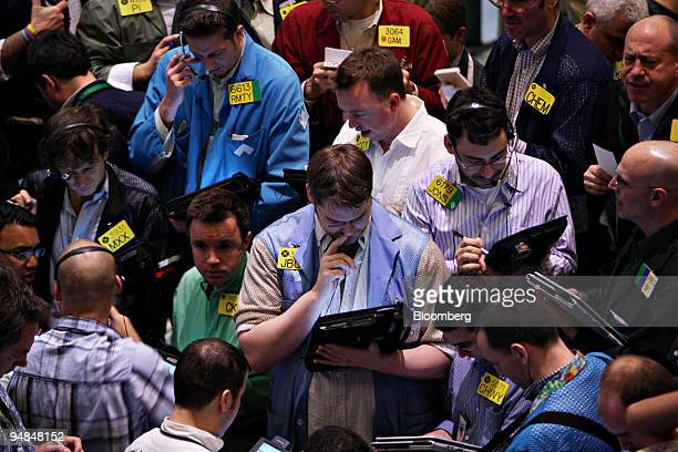 Traders work in the crude oil options pit at the New York Mercantile Exchange in New York US on Thursday April 17 2008 Crude oil was little changed...