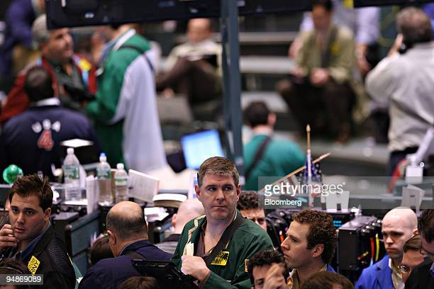 Traders work in the crude oil options pit at the New York Mercantile Exchange in New York, U.S., on Monday, March 17, 2008. Crude oil fell more than...