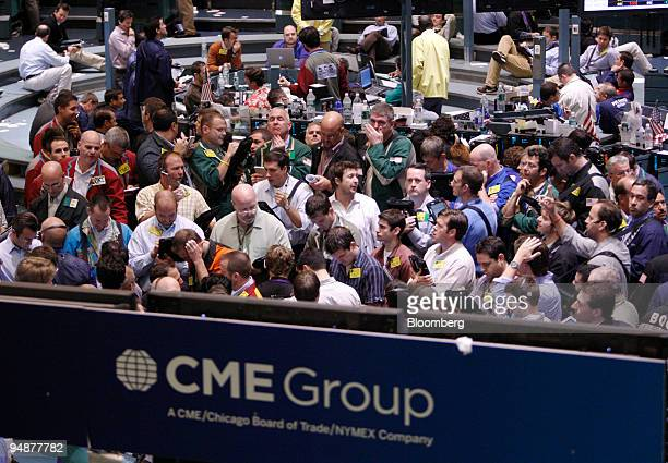 Traders work in the crude oil options pit at the New York Mercantile Exchange in New York US on Monday Oct 6 2008 Stocks tumbled around the world the...