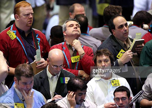Traders work in the crude oil options pit at the New York Mercantile Exchange in New York US on Wednesday Feb 20 2008 Crude oil was little changed...