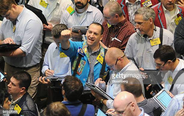 Traders work in the crude oil options pit at the New York Mercantile Exchange in New York US on Wednesday March 4 2009 Crude oil rose for a second...