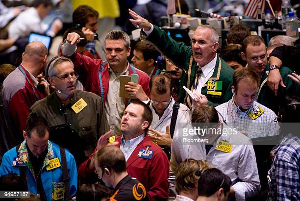 Traders work in the crude oil options pit at the New York Mercantile Exchange in New York US on Friday Dec 5 2008 Crude oil fell for a sixth day...