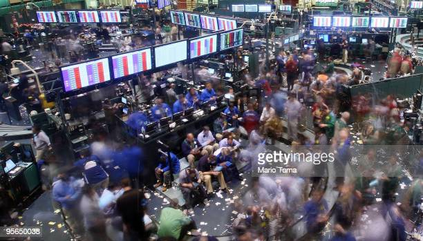 Traders work in the crude oil options pit moments before the closing bell at the New York Mercantile Exchange January 8 2010 in New York City Crude...