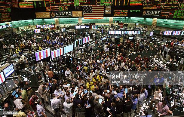 Traders work in the crude oil options pit of the New York Mercantile Exchange February 20 2008 in New York City Oil prices hit new record highs above...