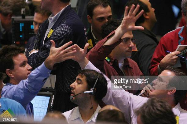 Traders work in the crude oil options pit on the floor of the New York Mercantile Exchange November 8 2007 in New York City Oil futures waffled today...