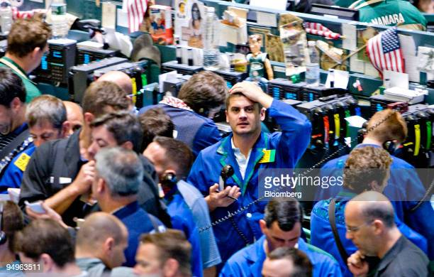 Traders work in the crude oil options pit on the floor of the New York Mercantile Exchange in New York US on Tuesday July 7 2009 Crude oil fell to a...