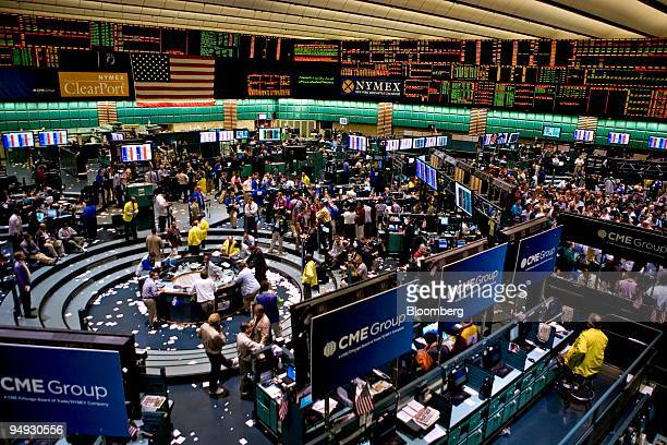 Traders work in the crude oil options pit right and in the crude oil futures pit at the New York Mercantile Exchange in New York US on Thursday Oct...