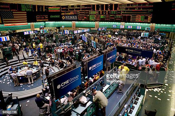 Traders work in the crude oil options pit right and the crude oil futures pit left at the New York Mercantile Exchange in New York US on Thursday Oct...