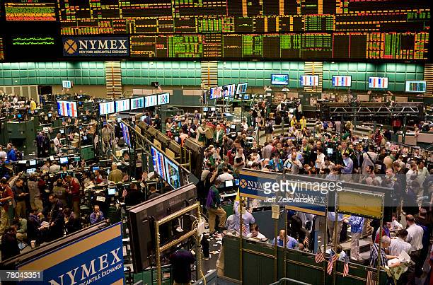 Traders work in the crude oil pit at the New York Mercantile Exchange November 21 2007 in New York City Prices hit a new record today of $9929 a...